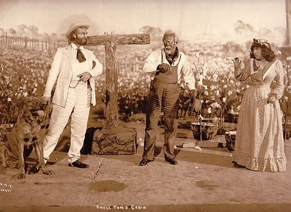 "A photograph of an early 1900s theatrical production of ""Uncle Tom's Cabin."""