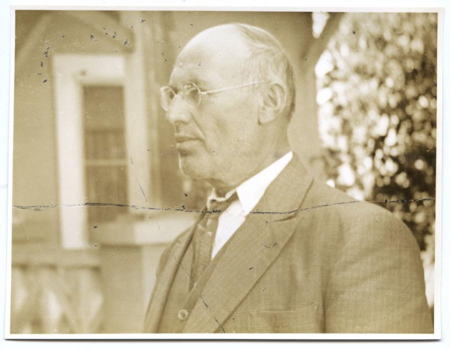 Sepia portrait of man in suite, side profile