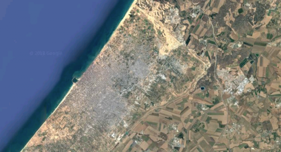 Gaza City on one side of the border, Israeli farms on the other.