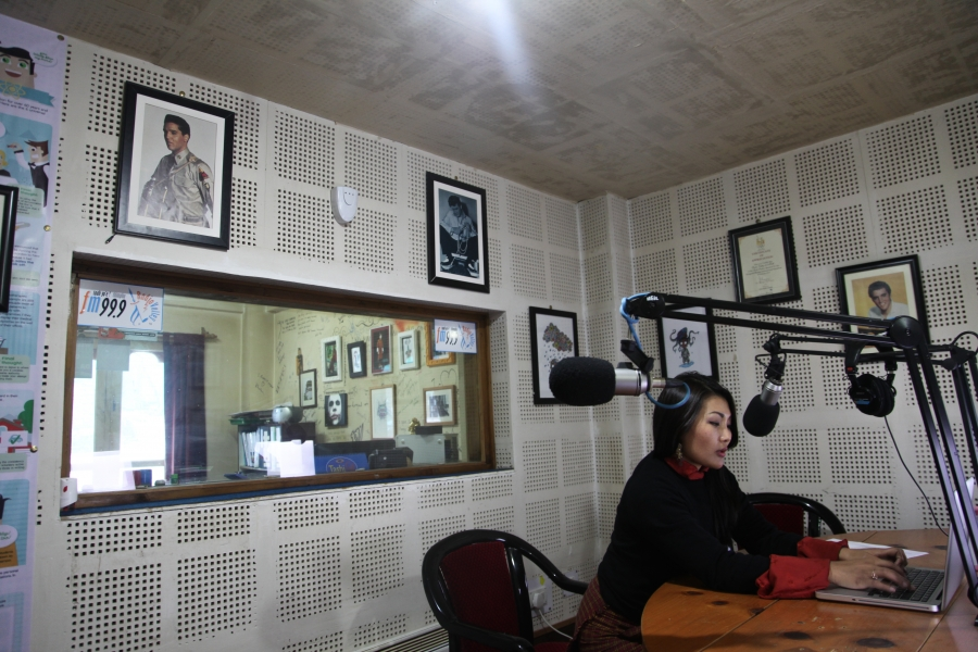 Namgay Zam prepares to record an episode of Mind Over Matter Bhutan in the studio at Radio Valley in Thimphu.