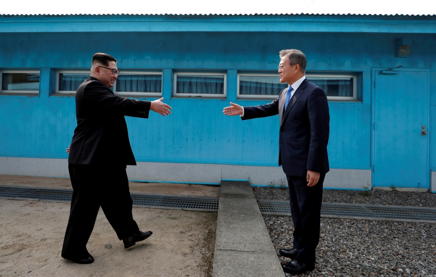 South Korean President Moon Jae-in and North Korean leader Kim Jong-un approach to shake hands during their-first ever meeting at the truce village of Panmunjom inside the demilitarized zone separating the two Koreas, April 27, 2018.