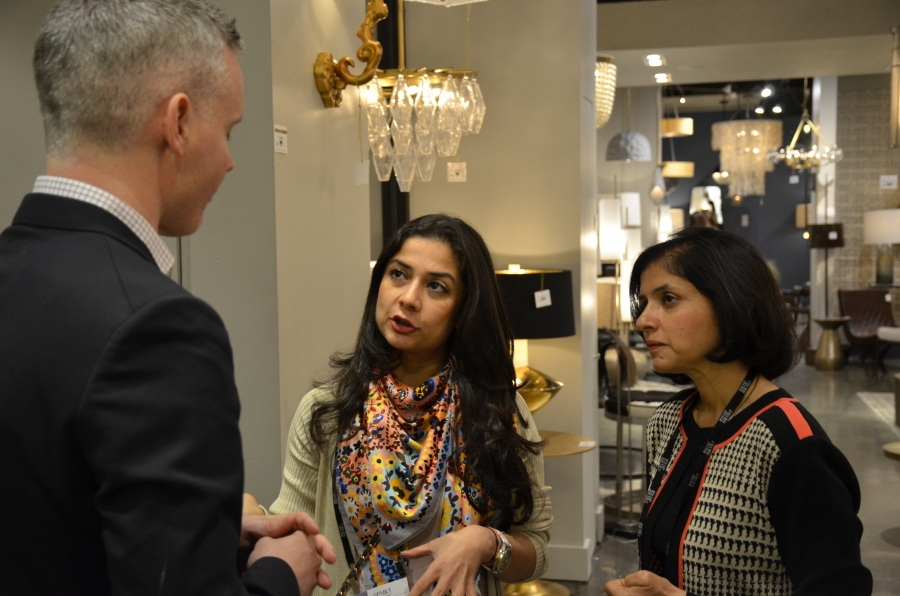 Approximately 10 percent of the nearly 80,000 visitors to The High Point Market are international. Indian interior designers Smita Prakash (left) and Divya Jain speak with Henry Hart, international sales manager with Arteriors.