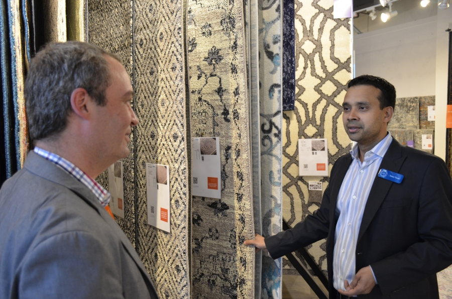Satya Tiwari (right) president of the Atlanta-based company Surya, shows a rug to John Mulliken, the CTO of Wayfair, one of the world's largest online sellers of furniture and home furnishings.
