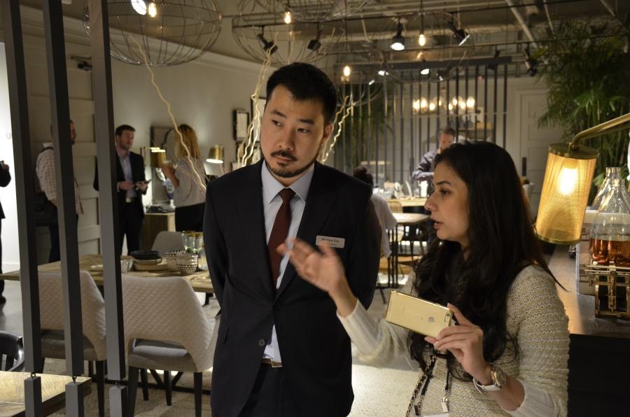 Smita Prakash and Matthew Kim look at furnishings at Universal Furniture's showroom in High Point.