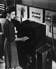 Frances Bilas Spence feeding punch cards into ENIAC, Feb 1946.