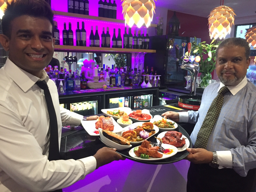 Sujat Sheikh, right, and his son at their restaurant called Mogul E Azam in Nottingham, England.