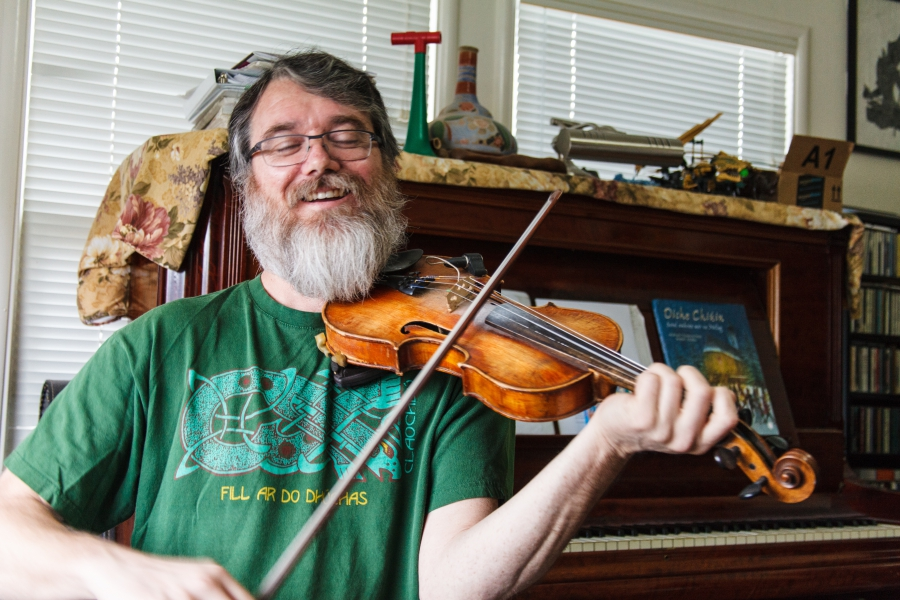 Galt Barber playing his fiddle at home in Santa Cruz, California.