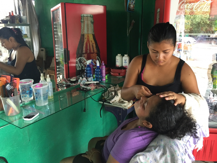Franci Machado, 26, works at a sidewalk beauty shop in Managua. Doctors refused to give her chemotherapy because it could kill her fetus, and that would violate Nicaragua's strict abortions law.