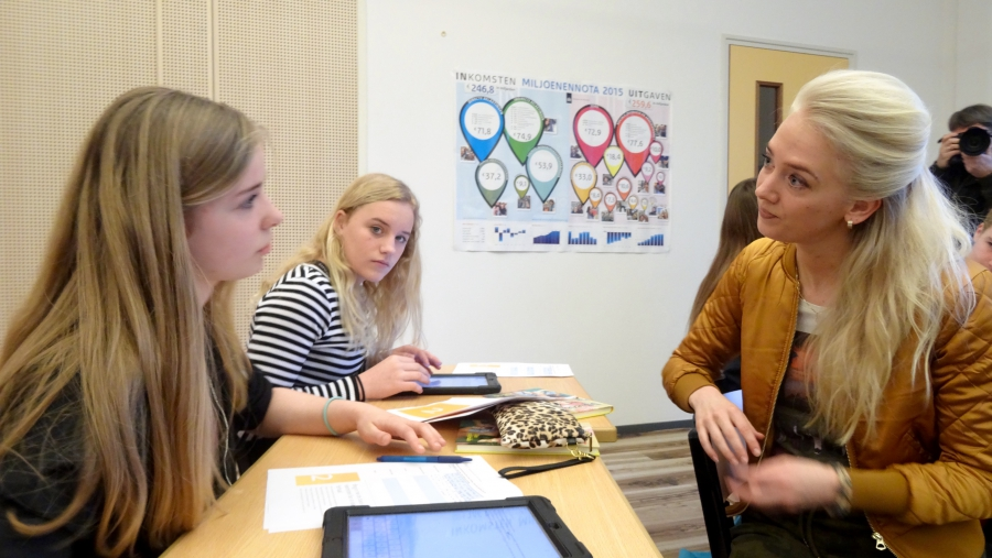 Frisian teacher Anna Marije Bloem discusses an essay topic with students.