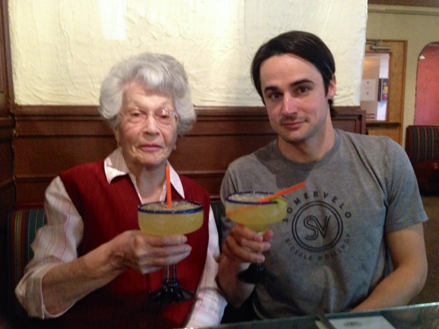 92-year-old Hortensia Campbell and her grandson, Bradley Campbell, toast to good health.