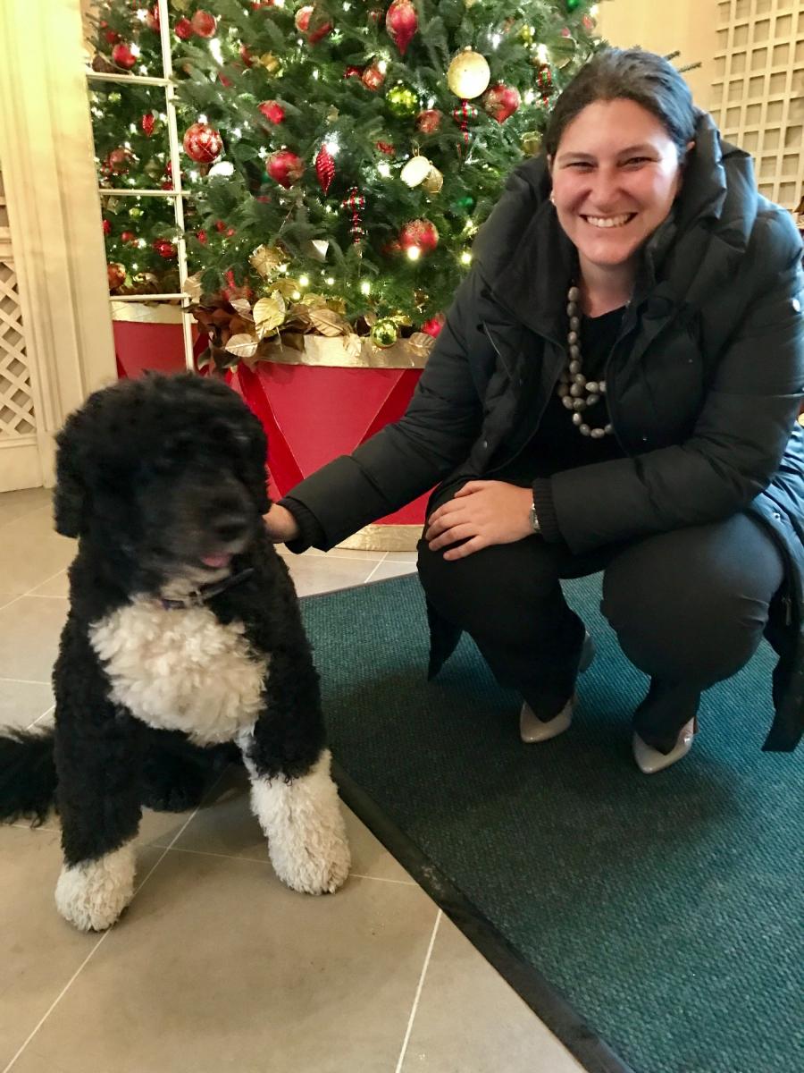 Gabriela Chojkier, Senior Director of Hispanic Media at the White House with Obama's dog Bo.