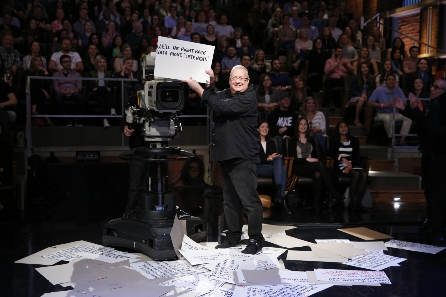"""Cue-card guy, Wally Feresten during a """"Late Night"""" sketch on May 11, 2016."""
