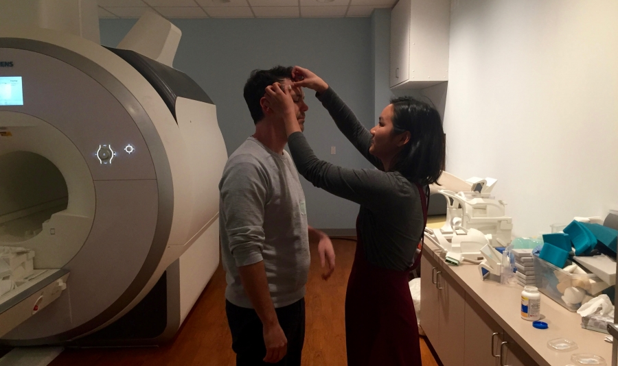 Researcher Lauren Jacobs prepares comedian Anthony Veneziale for a fMRI session at a laboratory run by Dr Charles Limb at the University of California, San Francisco.