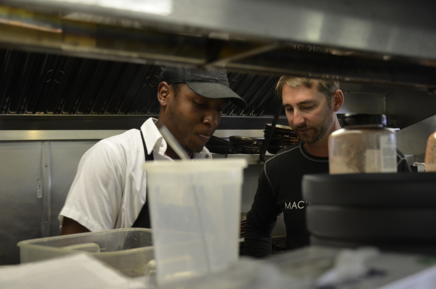 """MacGregor """"Mac"""" Hay (right) and Ansel Matthewson in the kitchen at Mac's Shack. In additional to owning restaurants, Hay owns a local motel and other properties to provide affordable housing for his seasonal workers."""
