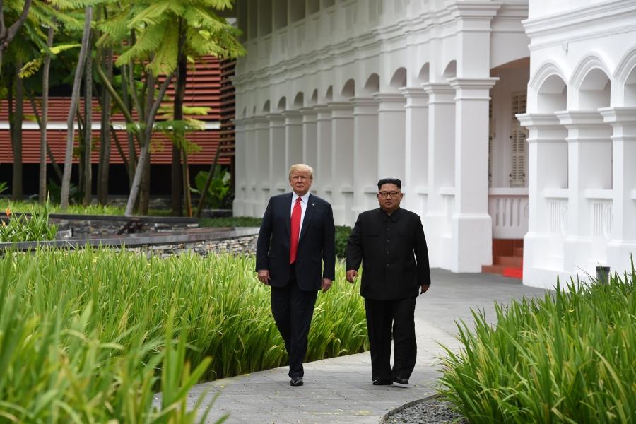 US President Donald Trump and North Korean leader Kim Jong-un walk in the lush, green gardens of Capella Hotel.