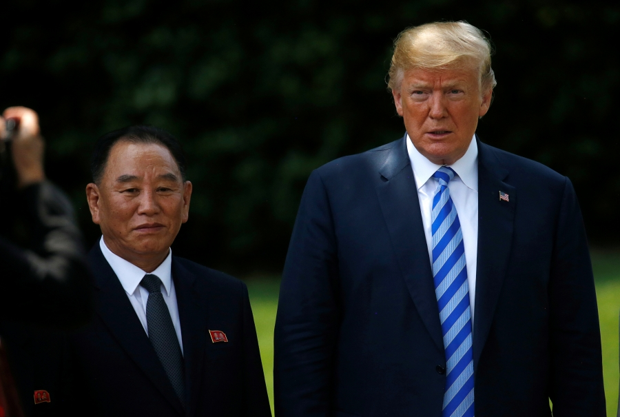 North Korean envoy Kim Yong-chol, the country's former spy chief and current vice-chairman of the Central Committee of the Workers' Party of Korea, poses with President Donald Trump after a meeting at the White House in Washington, DC, June 1, 2018. Kim Y