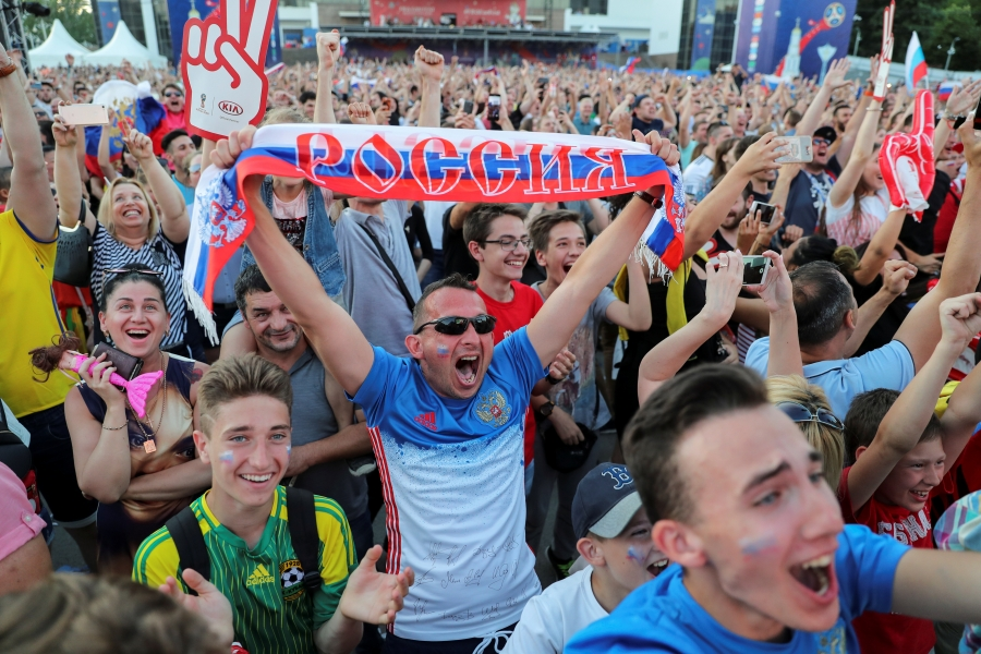 Russia fans celebrate as the Russian national soccer team scores in a 5-0 victory over Saudi Arabia to open the 2018 World Cup, in Rostov-on-Don, Russia, June 14, 2018.