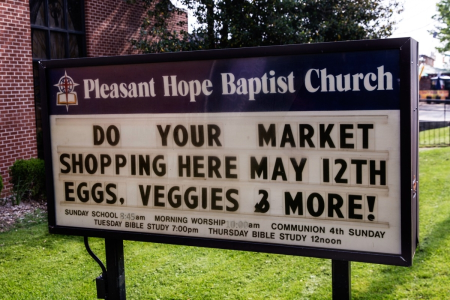 a church sign advertising fresh produce in baltimore