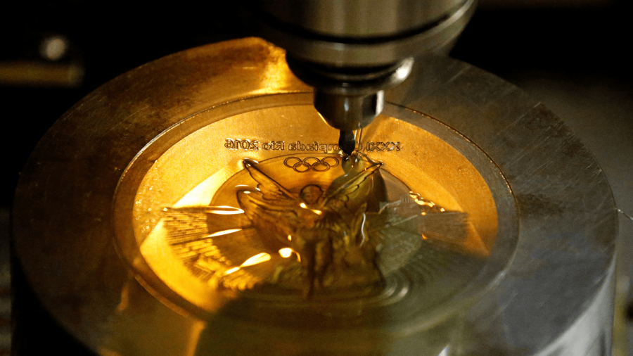 a machine makes a medal in brazil for olympic winners