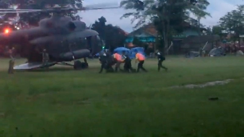 Paramedics, believed to be carrying a boy who has been evacuated after being trapped inside a flooded cave, approach a helicopter in Chiang Rai, Thailand, July 8, 2018, in this still image obtained from social media.