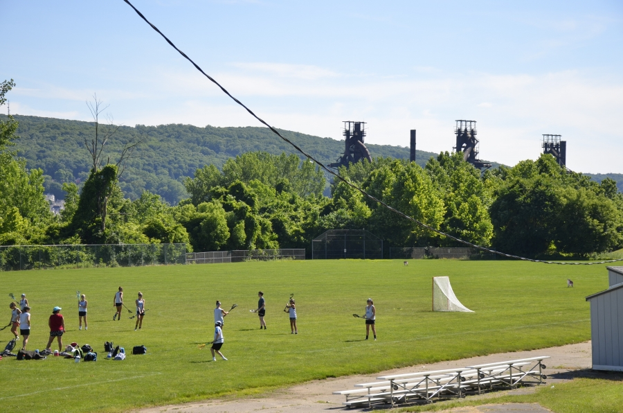 Lacrosse players in the shadow of the old Bethlehem Steel mill.