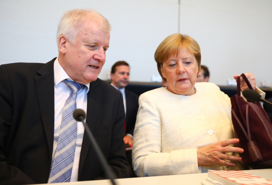 German Chancellor Angela Merkel and Interior Minister Horst Seehofer, who is also the leader of the Christian Social Union in Bavaria, meet in Berlin, Germany, July 3, 2018. The coalition partners reached a deal on tightening border procedures to limit mi