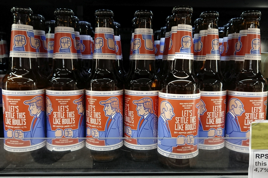 "Beer labeled ""Let's Settle This Like Adults,"" produced by Finnish Rock Paper Scissors brewing company, is seen in a grocery store ahead of President Donald Trump and Russian President Vladimir Putin's summit in Helsinki, Finland, July 11, 2018."