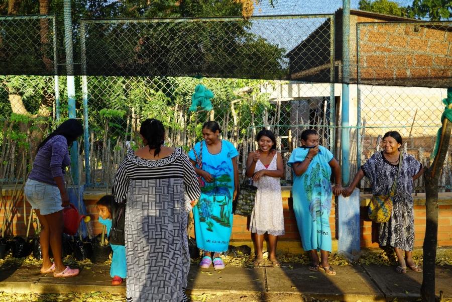 6 women stand in a garden
