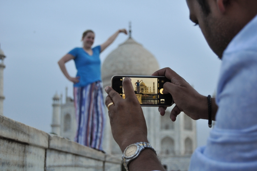 a picture of someone taking a picture of the Taj Mahal
