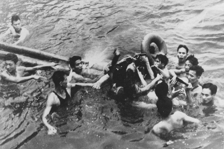 John McCain is pulled out of a Hanoi lake by a mix of North Vietnamese Army (NVA) and Vietnamese citizens