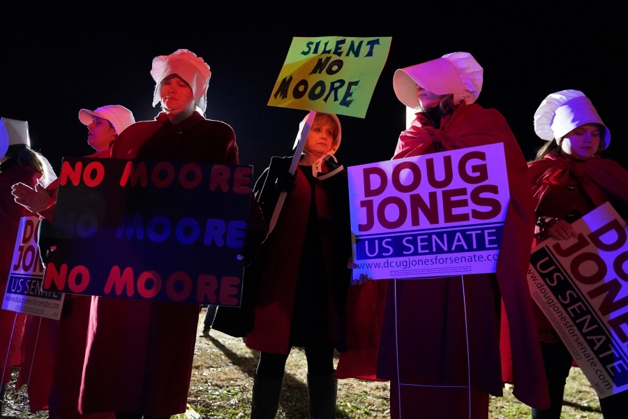 Women protest at the exit gate after a Roy Moore campaign rally in Midland City, Alabama, December 2017. Moore, the Republican candidate for the Alabama senate seat previously held by Jeff Sessions, lost to Democrat Doug Jones.
