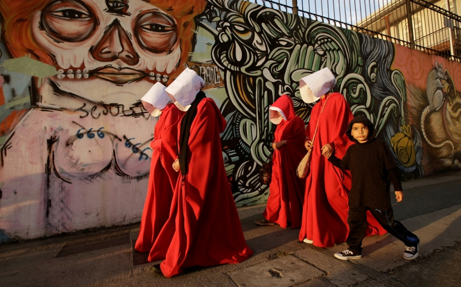 Activists dressed as handmaids take part in a demonstration against the proposed policies of the presidential candidate Fabricio Alvarado, an evangelical Christian of the National Restoration party in San Jose, Costa Rica, in March 2018.