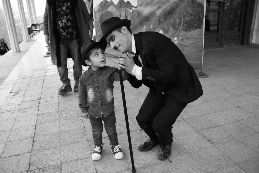 Karim Asir greets an audience member.