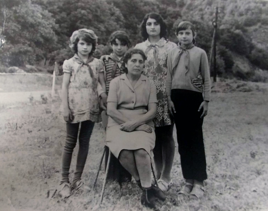 Four members of the Young Pioneers pose with an older woman