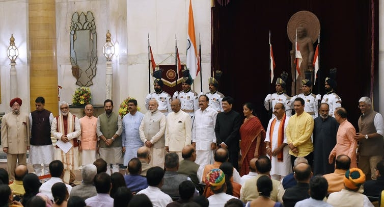 PM Modi and all of his ministers, who are all men with the exception of one woman