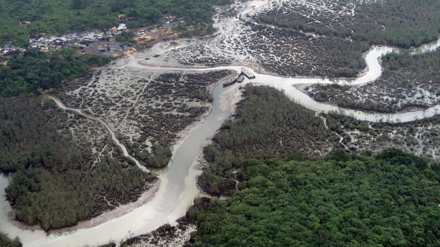 An aerial photo shows oil spills in a river delta
