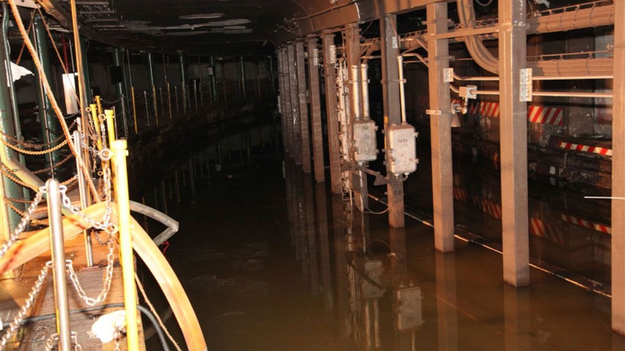 Floodwaters fill an underground subway tunnel