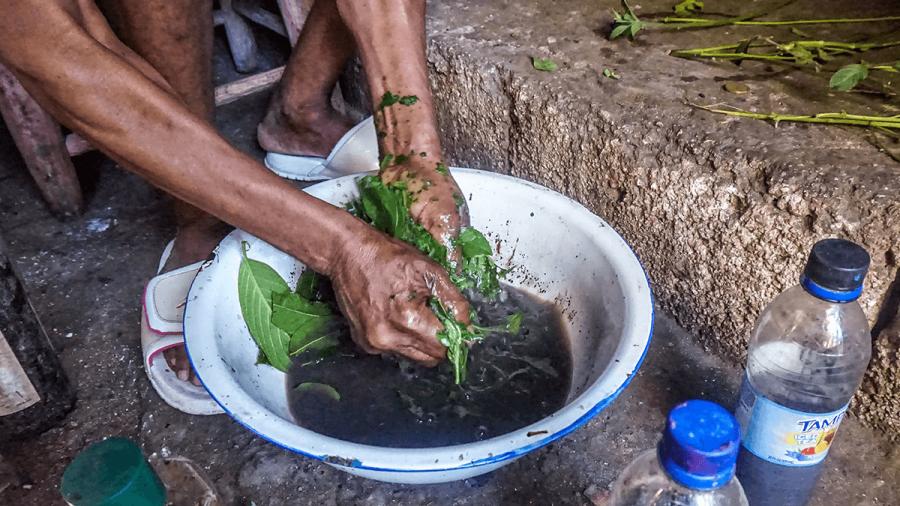 a woman prepares herbs for a treatment
