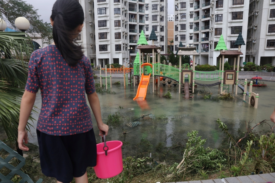 a flooded park with a woman in front