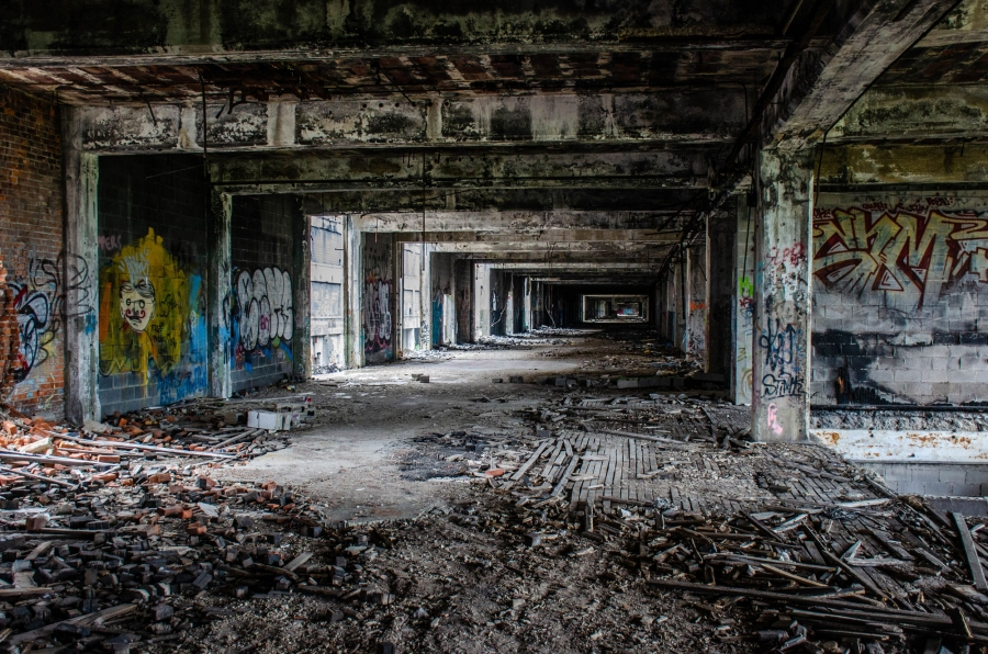 A look inside the old Packard Plant showing grafitti, bricks and other debris everywhere and a general bombed-out look.