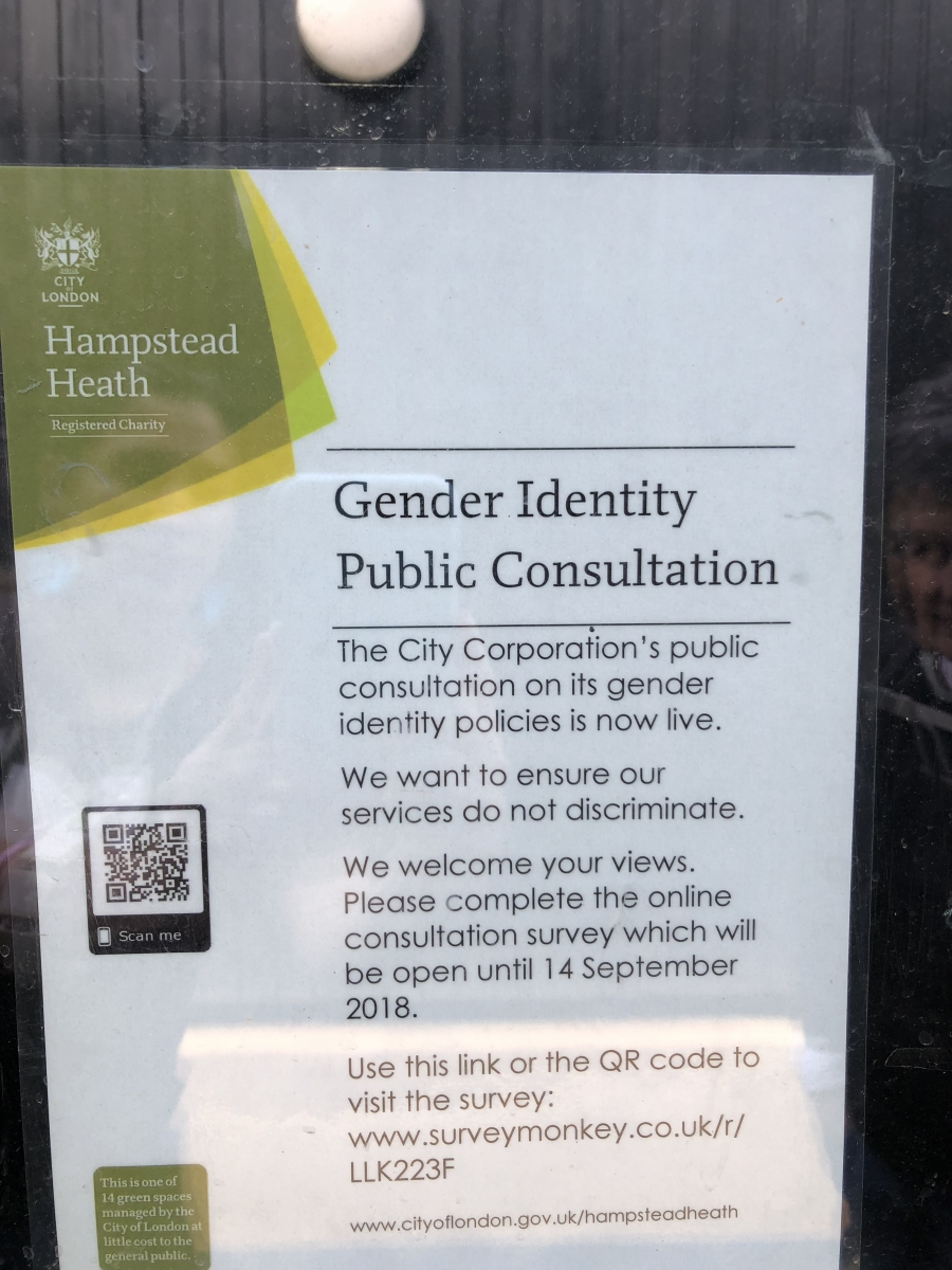 A sign on the window of the office at the Hampstead Heath Ladies' Pond stating that transgender women are allowed at the pond.