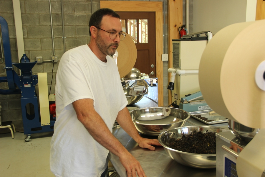 """Steve Lorch in his garage turned """"micro factory."""" He estimates that it costs about $250,000 to start a small tea company in the US. He has been able to set up shop for a fraction of that cost, getting creative and tinkering with some of his machines."""