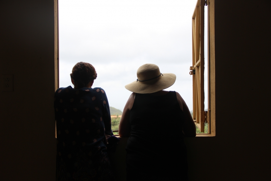 two women looking out of window