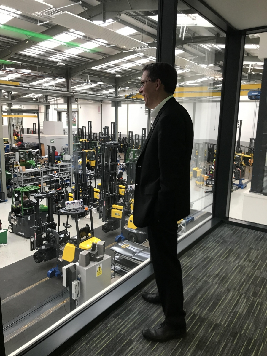 the manager of a forklift factory looks out at the plant in ireland