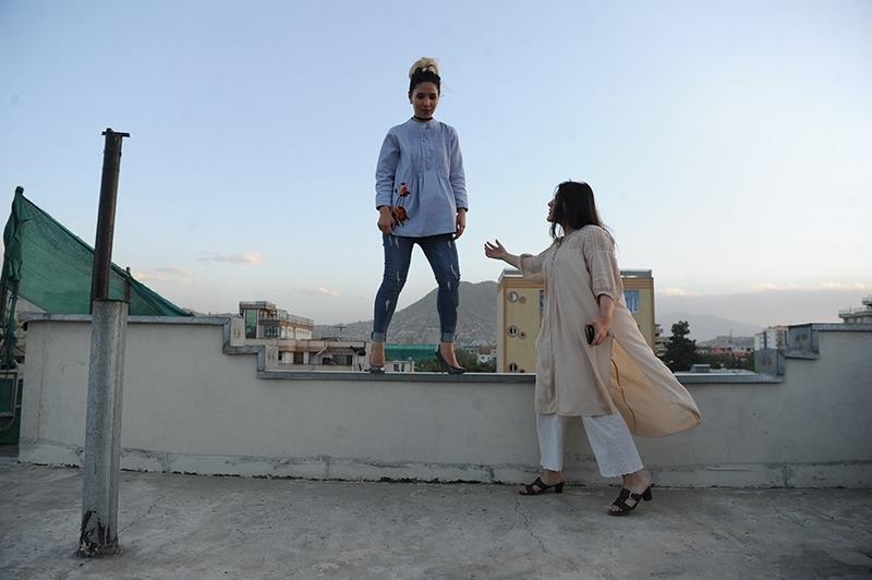 Fashion designer Rahiba Rahimi directs her model, Marzie Noori in Kabul, Afghanistan.