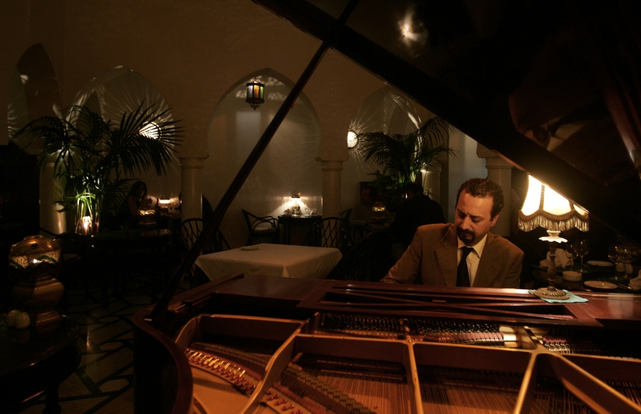 Pianist Issam Chabaa plays at Rick's Cafe in Casablanca