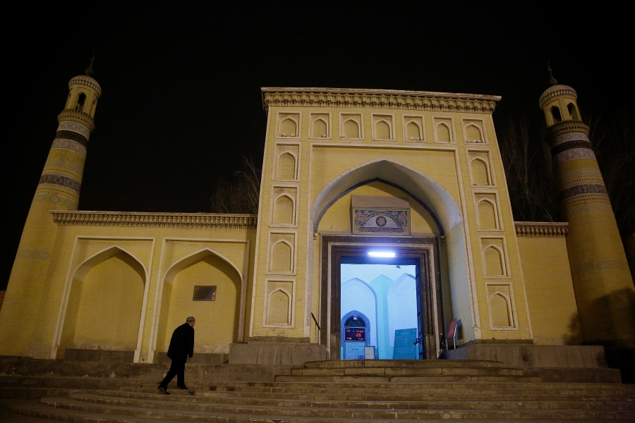 A man arrives at the Id Kah Mosque for morning prayers in Kashgar.