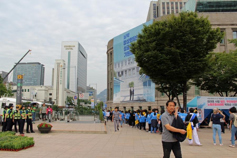 a man walks near seoul city hall