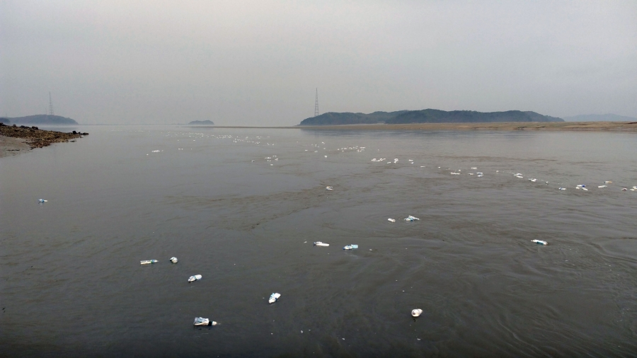 Dots of white are water bottles filled with rice and USB drives as they float in the sea, hopefully washing up in North Korea.