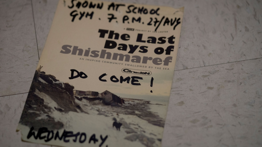 "A flyer says ""The Last Days of Shishmaref"" and handwriting on it says a time and date and a ""Do come!"""
